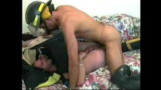 Fireman fucks gay police officer's ass on couch then cums on his abs